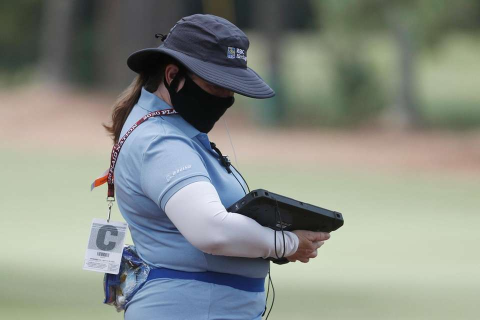 An official wears a mask, during the first