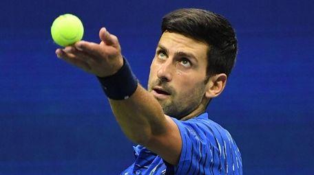 Novak Djokovic serves to Stan Wawrinka during the
