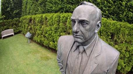 A statue of Robert Moses, who shaped New