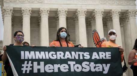 DACA recipients and their supporters rally outside the