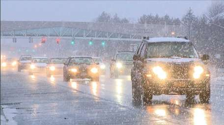 Motorists take it slow in the snow on