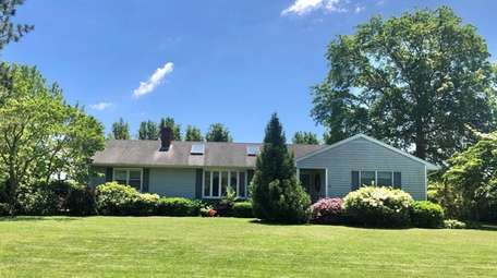This three-bedroom, 1½-bath house in Jamesport, listed for