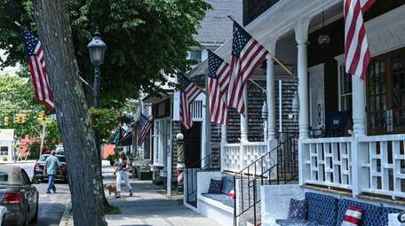 Flags on porches in Bellport Village