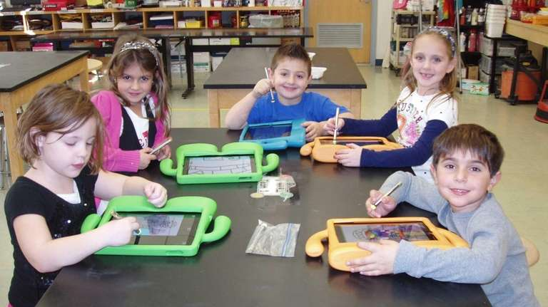 Babylon Elementary School first-graders use an app and