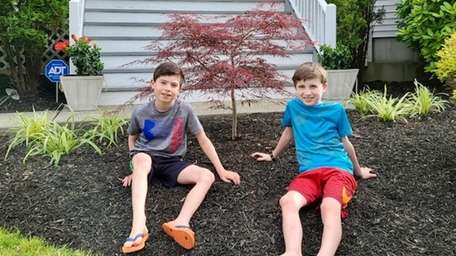 Shana Dempsey's children, Logan and Dylan, in front