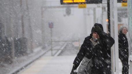 An LIRR commuter battles the blowing snow after