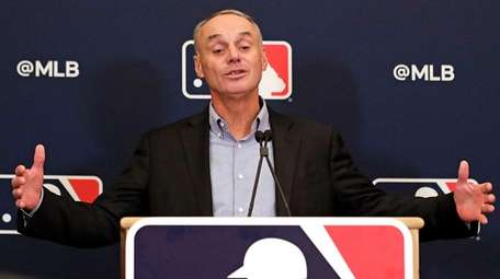 MLB Commissioner Rob Manfred answers questions at a