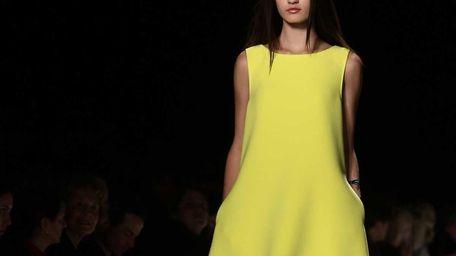 A model shows off designs by Rebecca Minkoff