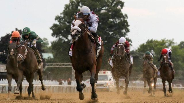 Tiz the Law, with jockey Manny Franco riding,
