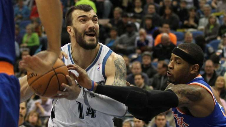 The Minnesota Timberwolves' Nikola Pekovic drives on the