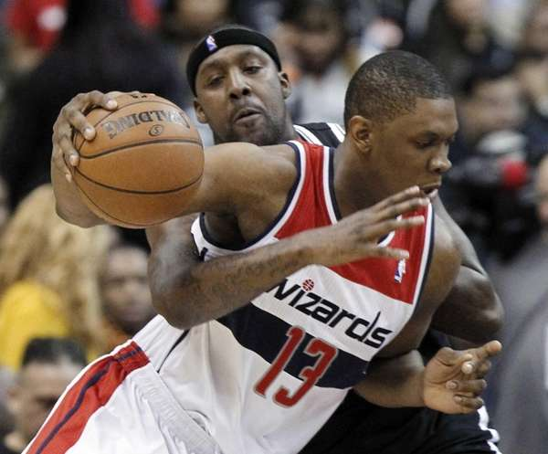 Andray Blatche, behind, reaches around Washington Wizards forward