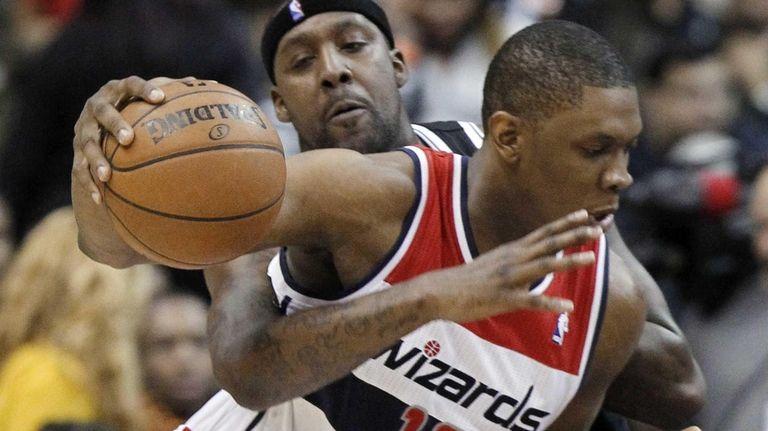 Andray Blatche, behind, reaches around Washington Wizards forward