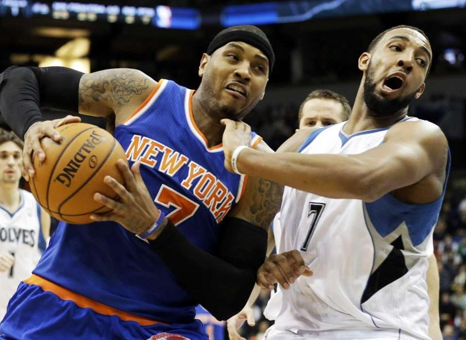 Carmelo Anthony drives around Minnesota Timberwolves' Derrick Williams