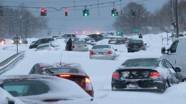 Snowbound vehicles remain stranded along Route 347 in