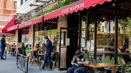 Customers dining at Five Napkin Burger on Ninth