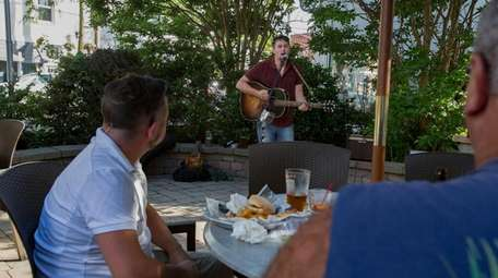 Nick Russell, 29, of Oakdale entertains the patrons