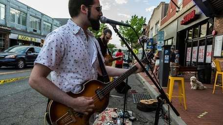 The Brian Ripps Band jams on the sidewalk
