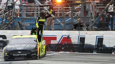 Ryan Blaney celebrates winning a NASCAR Cup Series