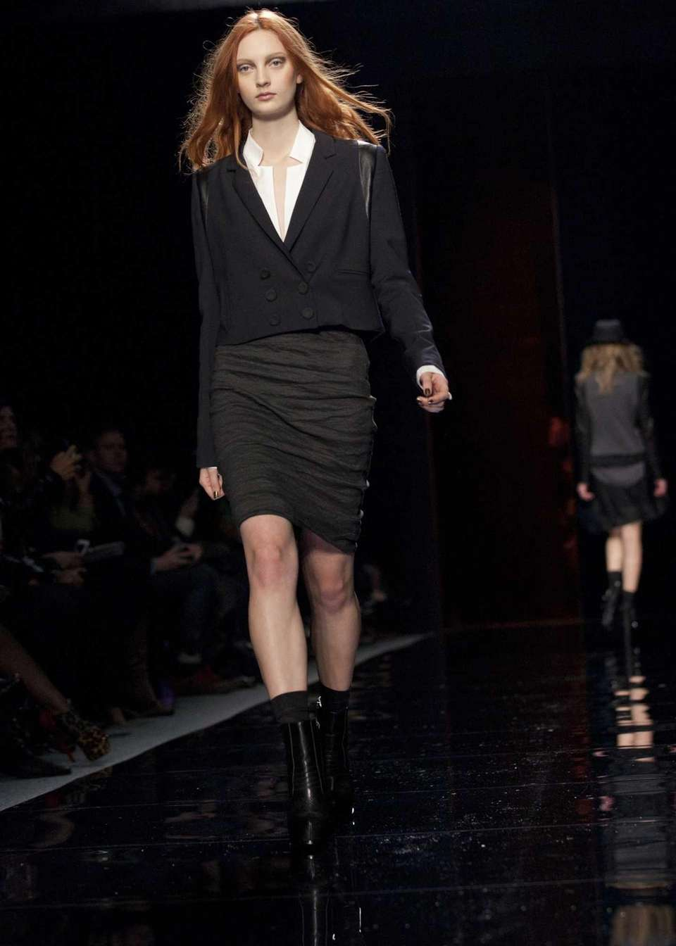 A model walks the runway during the Nicole