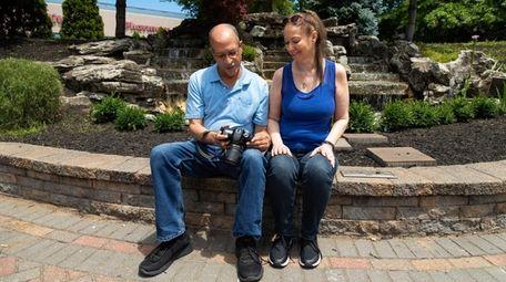 Doug McQuillan of Westbury reviews photos on his