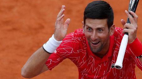 Novak Djokovic reacts during a tennis doubles match