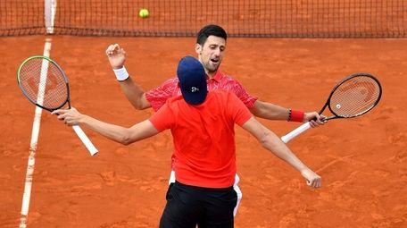 Serbian tennis players Novak Djokovic (back) and Filip