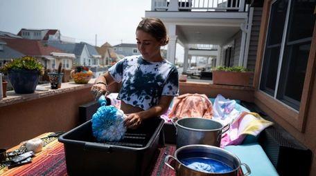Dakota Skye Ejnes, 20, of Long Beach, distributes