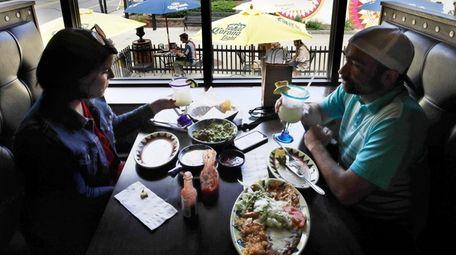Trish, left, and John Portanova dine inside instead