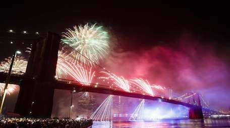 Fireworks light up the sky above the Brooklyn