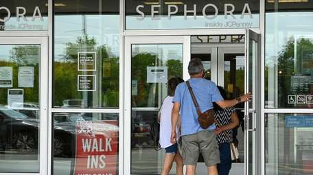 Customers enter J.C. Penney at Westfield South Shore