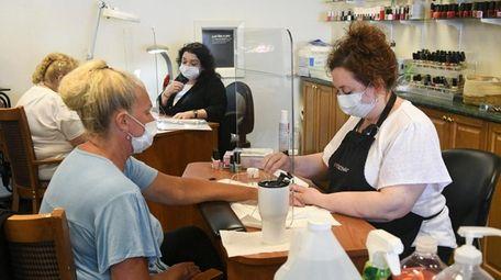 Customers and employees at LI nail salons will