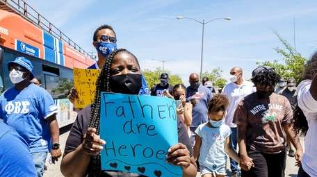 Demonstrators carry signs, chant, and march Sunday from