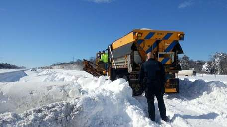 A New York State DOT plow is stuck