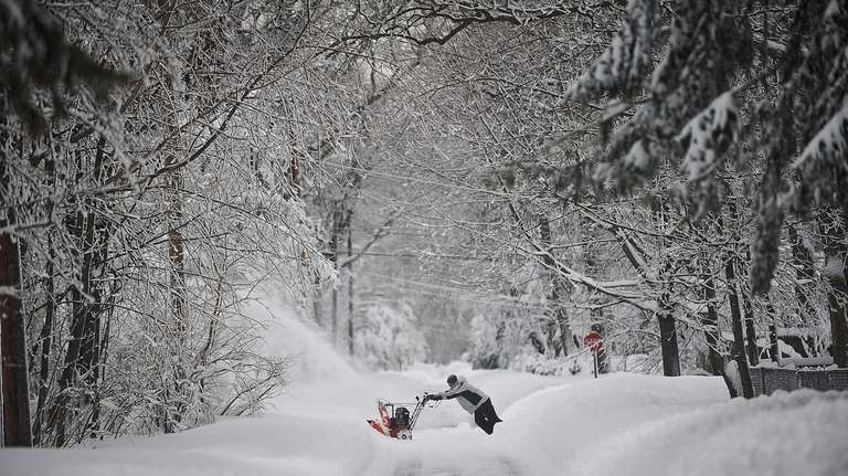 Luke Gentile clears his driveway in St. James.