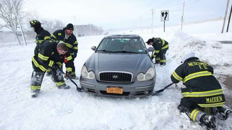Firefighters from Nesconset and St. James help dig