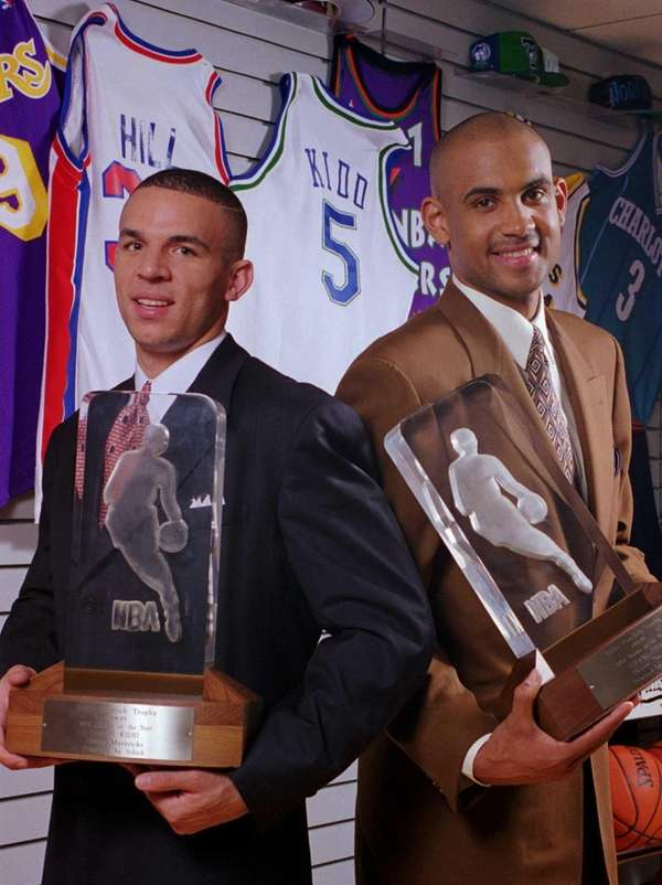 Jason Kidd, left, and Grant Hill hold their