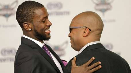 Charlotte Hornets' Michael Kidd-Gilchrist, hugs longtime friend William