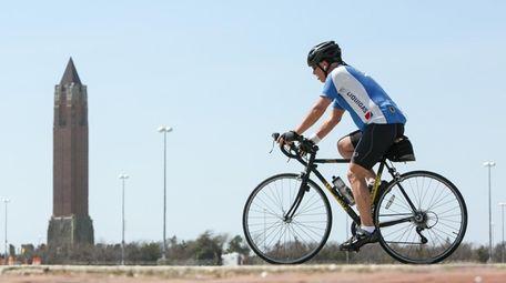 A man rides his bike at Jones Beach