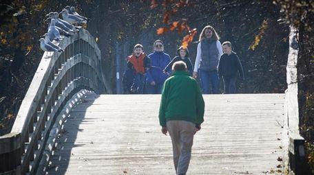 People walk on the boadwalk at Sunken Meadow