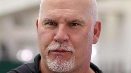 Jets offensive line coach Frank Pollack speaks to