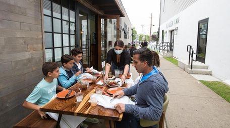 The Crispo family, of Deer Park, dine in