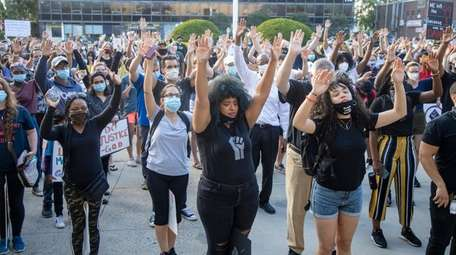 Racially and ethnically diverse demonstrators protest against police