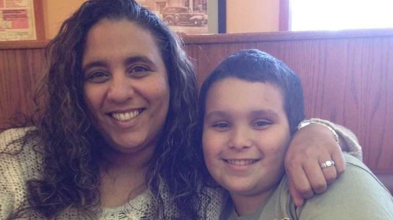 Nancy Inzalaco and her son, Christopher Cobian, 10.