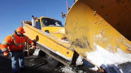 Highway Maintenance Supervisor Ryan Cole inspects the blade