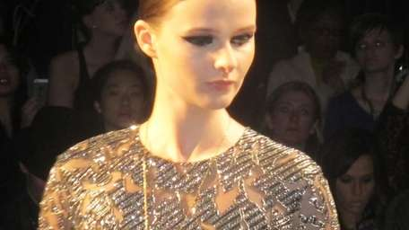 A model walks the runway for Monique Lhuillier
