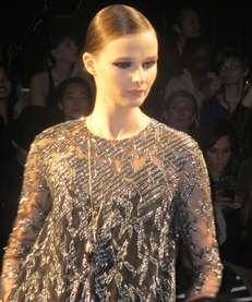A model walks the runway for Monique Lhuillier