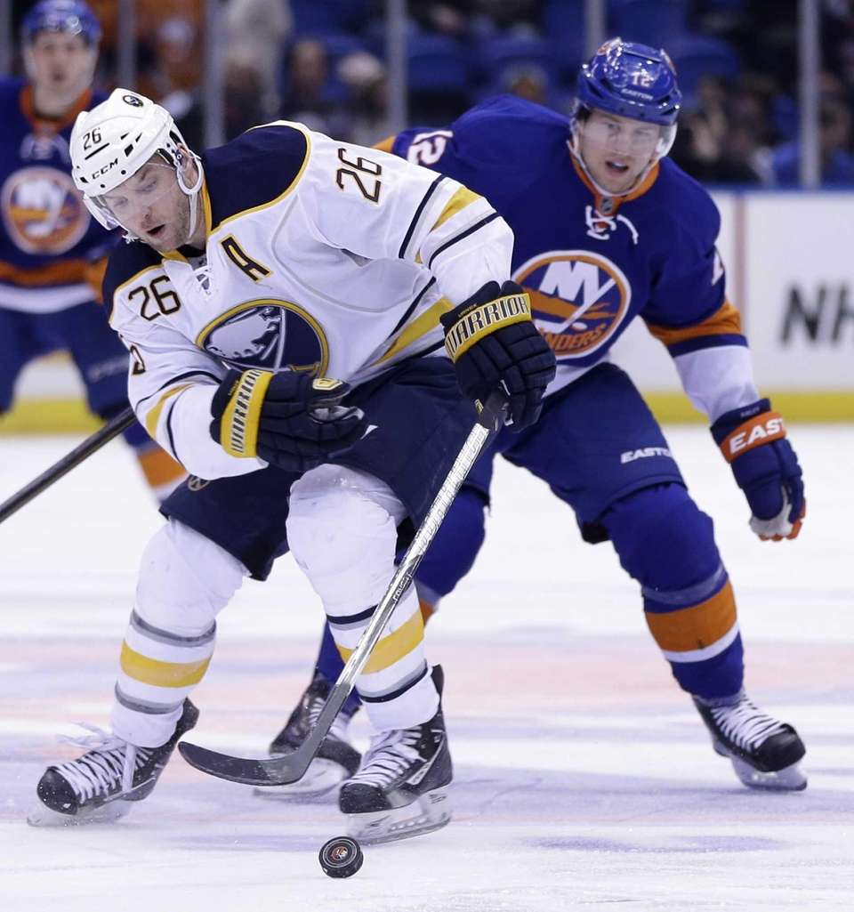 Buffalo Sabres' Thomas Vanek, left, keeps the puck