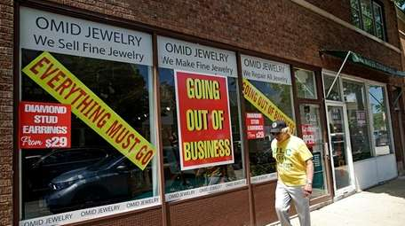 Signs at a jewelry store show that it