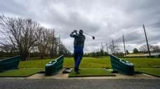 Golf enthusiasts practice their skills at the Town