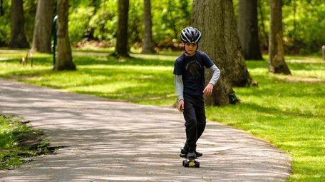 Artemi Takshait, of Forest Hills, practices his skateboarding